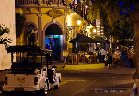 The little pulmonia taxis are the way to get around Mazatlan; this one is parked on Plaza Machado, fronting Cafe Pacifico, the oldest bar in town.