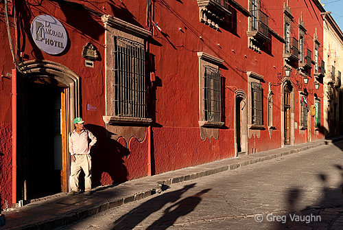 Man in doorway of La Morada Hotel in San Miguel de Allende, Mexico.
