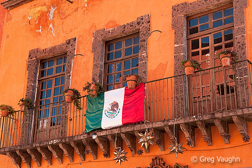 Mexican flag on balcony in San Miguel de Allende