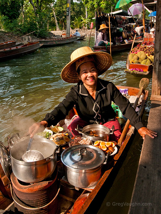 Woman selling food from boat at Damnoen Saduak Floating Market in Ratchaburi, Thailand